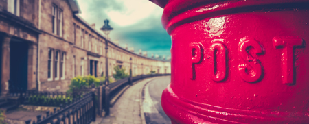 Panorama Of A Traditional British Red Post Box In A Curved Edwardian Terrace Street With Shallow Depth Of Focus Archivio Fotografico
