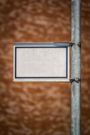 Grungy Blank White Street Sign For Your Text Against A Blurred Red Brick Wall Background