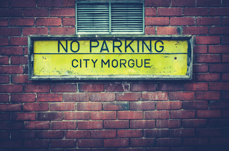 A No Parking Sign Outside A City Morgue In A US City Stock Photo