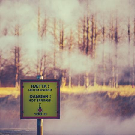 A Danger Hot Springs Sign In Iceland With Steam