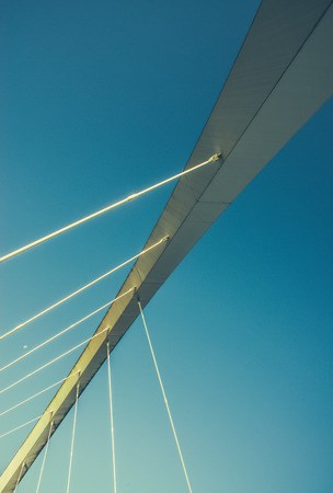 Abstract Architectural Detail Of A Span Of A Suspension Bride With Blue Sky And Copy Space