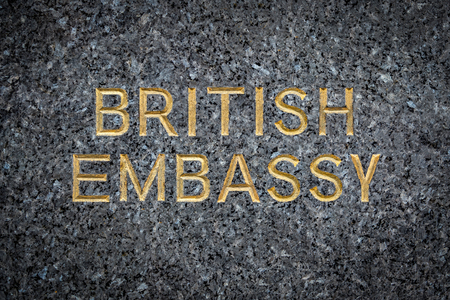 A Gold Embossed Sign For The British Embassy On Marble