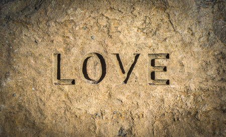 Conceptual Image Of The Word Love Chiseled Into Stone Or Rock