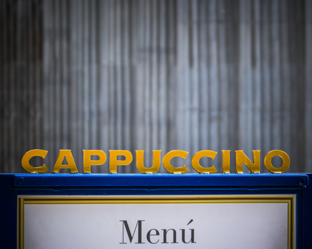 A Sign For Cappuccino At An Urban Coffee Shop With Copy Space