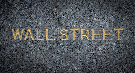 A Gold Engraved Sign For Wall Street In New York City (NYC) On Marble