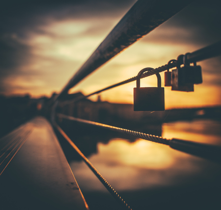 A Padlock Symbolising Love On A Bridge In Paris During A Beautiful Sunset
