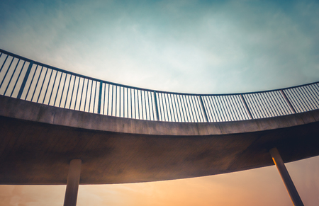 Abstract Urban Architecture Detail Of A Curved Footbridge Overpass At Sunset With Copy Space Stock Photo