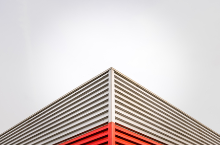 Abstract Architecture Detail Of A Factory Roof Corner Against An Overcast Sky With Copy Space Stock Photo