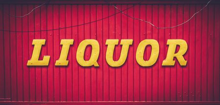 Grungy Urban Red And Yellow Liquor Store Sign