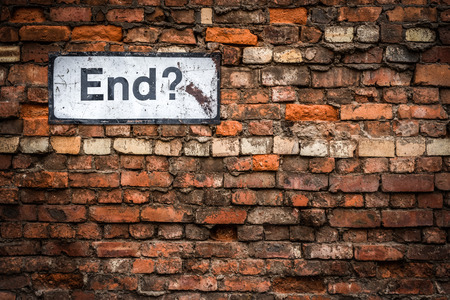 Uncertainty Concept Image Of A Grungy Sign Saying End? On An Old Red Brick Wall Stock Photo