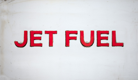 An image of a sign for JET FUEL on a white background.