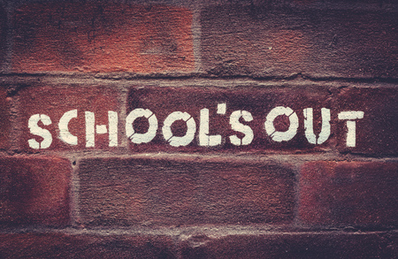 Urban School's Out Stencil Graffiti On A Red Brick Wall