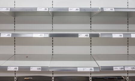 Empty Supermarket Shelves After Panic Buying During The Coronavirus Pandemic Фото со стока