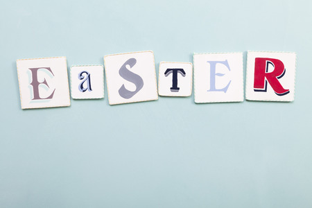 easter sign: Easter sign. Handwritten colors letters word. Light blue background. Calligraphy and lettering fine art. Stock Photo