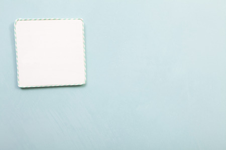 writable: Empty sign. One writable handmade blank spaces. Light blue background. Calligraphy and lettering fine art. Stock Photo