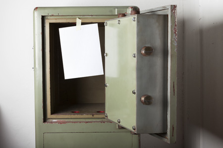 emptied: Theft. Domestic burglary. Safe box armoured emptied by thieves with message of thanks on paper - left blank. Write on it. Stock Photo