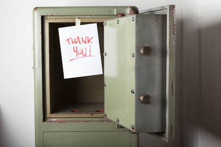 emptied: Domestic burglary. Safe box armoured emptied by thieves with message of thanks on paper: THANK YOU. Stock Photo