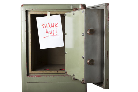disrupt: Theft. Domestic burglary. Safe box armoured emptied by thieves with message of thanks on paper: THANK YOU. Isolated on white