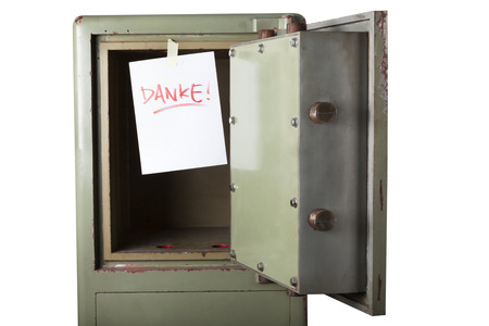 emptied: Theft. Domestic burglary. Safe box armoured emptied by thieves with message of thanks on paper: DANKE. Isolated on white Stock Photo
