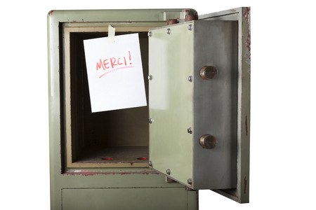 emptied: Theft. Domestic burglary. Safe box armoured emptied by thieves with message of thanks on paper: MERCI. Isolated on white Stock Photo
