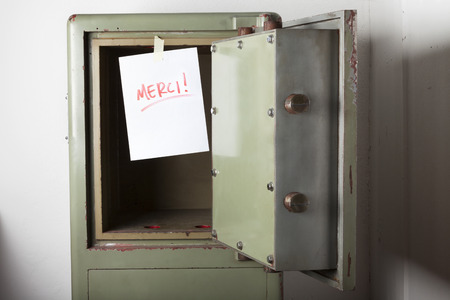 emptied: Theft. Domestic burglary. Safe box armoured emptied by thieves with message of thanks on paper: MERCI