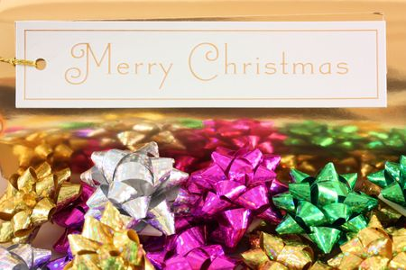 Merry Christmas with colourful bows photo