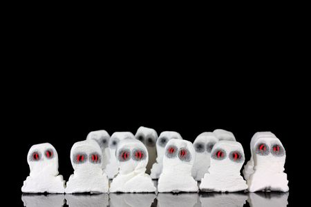 Evil white ghosts in a crowd with black space photo