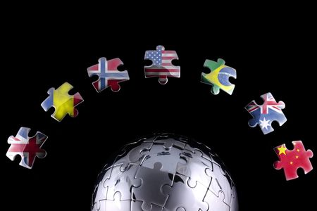Jigsaw flags around a chrome globe