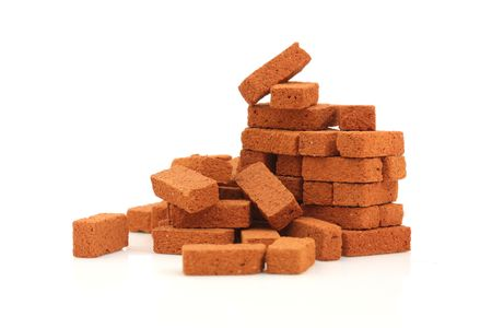 Big pile of bricks isolated Stock Photo - 6120392