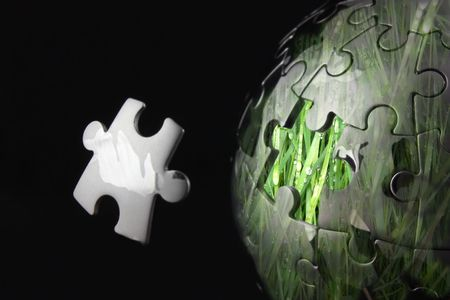 Chrome jigsaw globe showing renewable energy concept