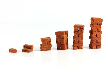 Columns of bricks isolated Stock Photo