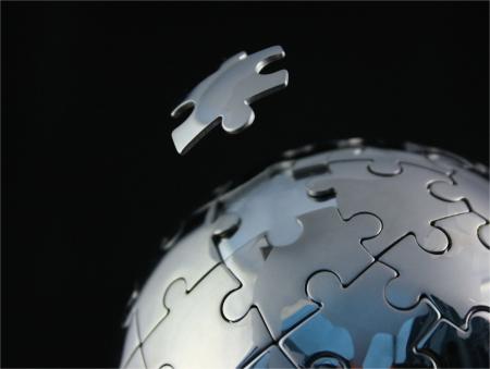 final piece of puzzle: Jigsaw Globe Chrome with floating last piece