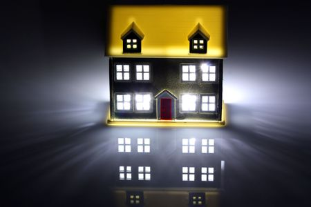 evening glow: One house lit at night Stock Photo
