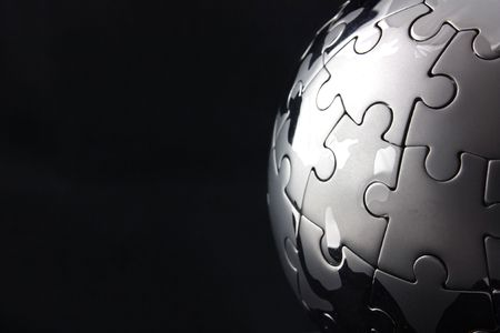 final piece of the puzzle: Globe jigsaw completed