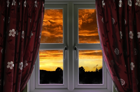 pane: Window with a view to a fiery sky