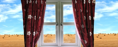 land locked: Window and curtains with view of crops Stock Photo