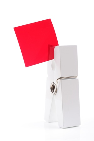 White peg holding red square isolated