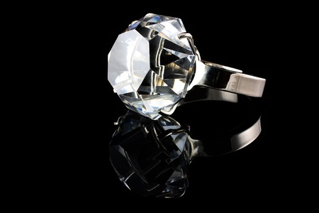Diamond ring on black background photo