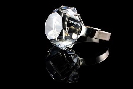 ring up: Diamond ring on black background