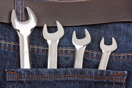 Spanners in jeans pocket photo