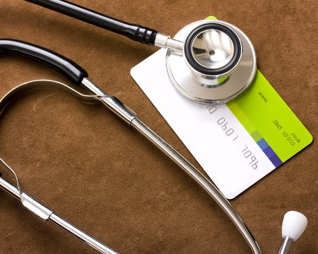 poor health: Stethoscope on a credit card