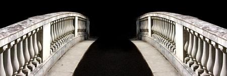bridging: Ornate bridge to nowhere on black Stock Photo
