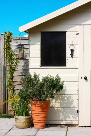 Garden shed and plants in spring Stock Photo