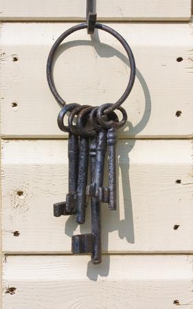 jailer: Old iron keys on a wooden