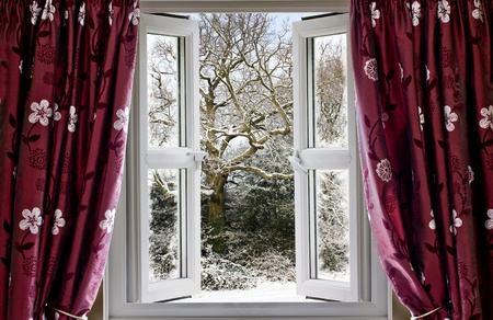 curtain window: Open window with view to a snowy winter scene Stock Photo