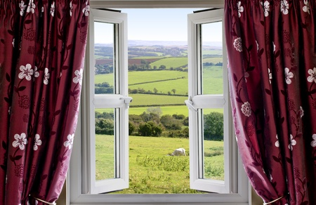 glazing: Open window with view across and English countryside Stock Photo
