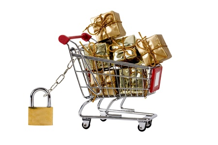 Secure shopping trolley with presents Stock Photo - 9647466