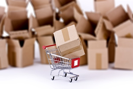 Shopping cart with many open boxes photo
