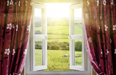 living room window: Open window with countryside view and sunlight streaming in