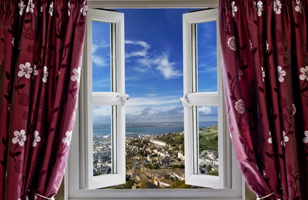elevated view: Open window with a view to the world Stock Photo